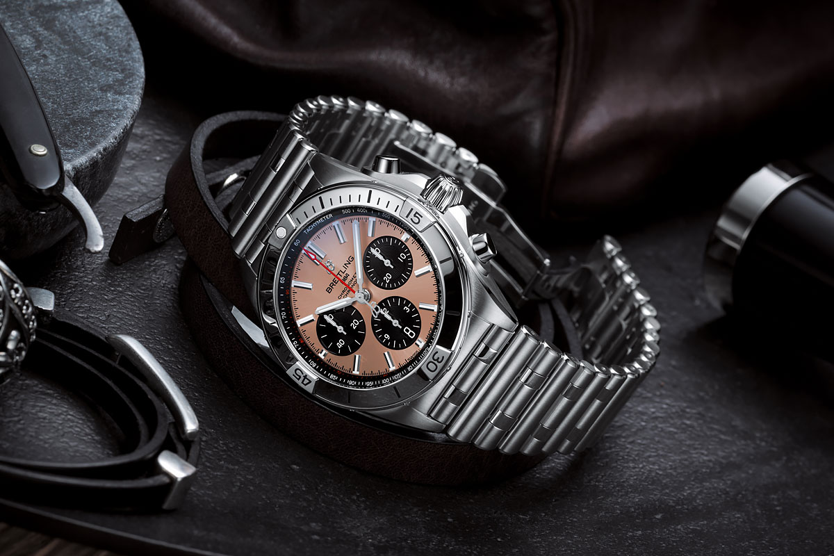breilting chronomat b01 42 with a copper colored dial and black contrasting chronograph counters